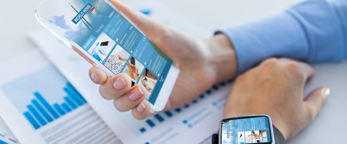 business, technology, mass media and people concept - close up of woman hand holding and showing showing news web page on transparent smartphone screen at office